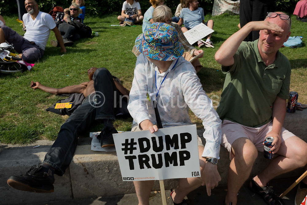 Protesters against the visit of US President Donald Trump to the UK, march through central London, on 13th July 2018, in London, England.