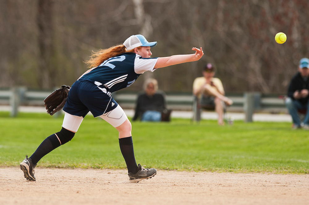 MMU's Danielle Bushey tosses the ball back hand to first base for the out during the girls softball game between BFA-St. Albans and Mount Mansfield at MMU High School on Thursday afternoon May 8, 2014 in Jericho, Vermont. (BRIAN JENKINS, for the Free Press)