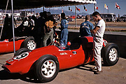 Pete Lyons engrossed in F1 Cooper at 1960 US Grand Prix at Riverside, his first time at this track; photo by Ozzie Lyons