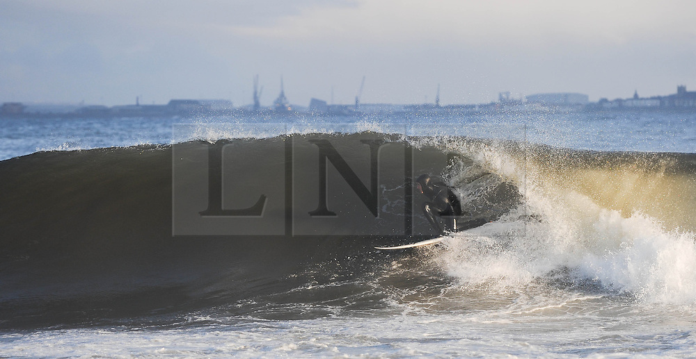 © Licensed to London News Pictures. 27/03/2014<br /> <br /> Cleveland, England<br /> <br /> Surfers on the north east coast of England enjoy an early morning surf.<br /> <br /> Photo credit : Ian Forsyth/LNP