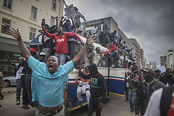 November 18, 2017 - Harare, Zimbabwe - People cheer a passing Zimbabwe Defense Force military vehicle during a demonstration demanding the resignation of Zimbabwe's president. Zimbabwe was set for more political turmoil with protests planned as veterans of the independence war, activists and ruling party leaders called publicly for President Mugabe to be forced from office. (Credit Image: © Belal Khaled/NurPhoto via ZUMA Press)
