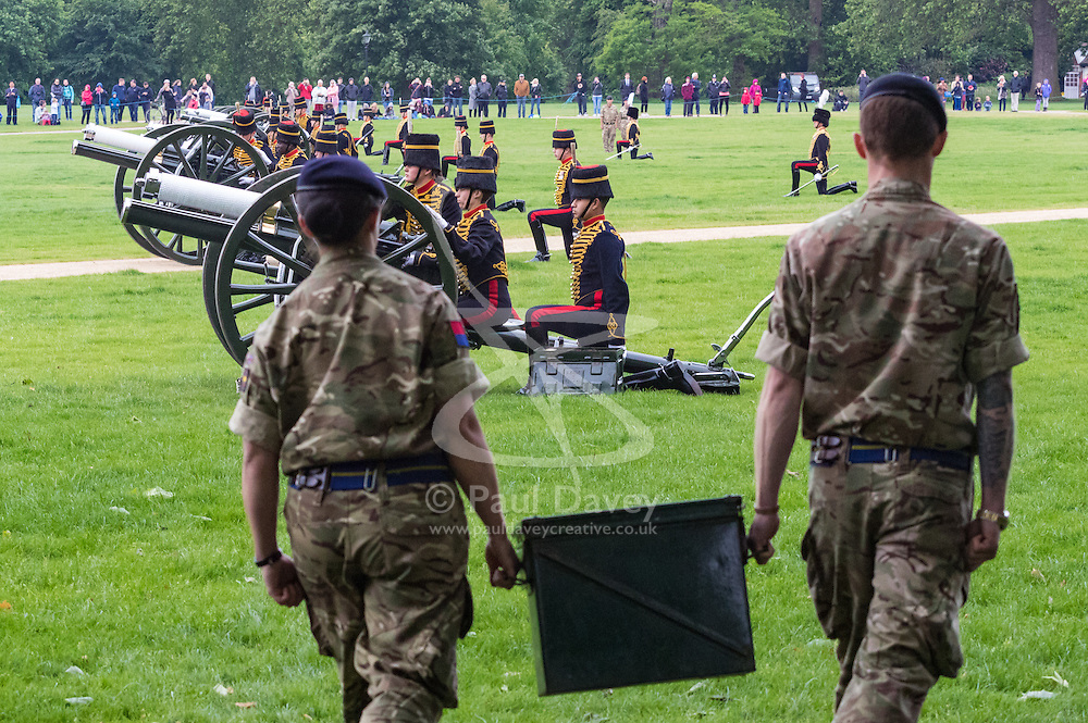 Hyde Park, London, June 2nd 2016. Soldiers and guns of the King's Troop Royal Horse Artillery fire a 41 round Royal Salute to mark the 63rd anniversary of the coronation of Britain's Monarch HM Queen Elizabeth II. PICTURED: Soldiers carry an ammunition box towards the malfunctioning gun number five.