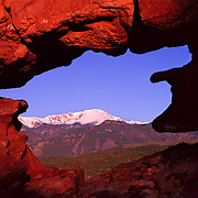 World famous Pike's Peak seen throught he window of the Siamese Twins in Garden of the Gods, Colorado Springs, CO.