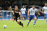 Newport County's Conor Washington gets away from Bury's Tommy Miller (r). Skybet Football League two match, Bury v Newport county at Gigg Lane in Bury on Saturday 5th Oct 2013. pic by David Richards, Andrew Orchard sports photography,