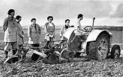 British girls of the Women's Land Army learning to plough with a tractor. World War II