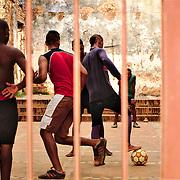 Boys playing a football match in the ruins of Santa Ana church