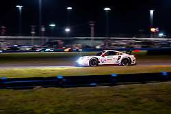 DAYTONA, FLORIDA - JANUARY 25, 2020: Porsche GT Team, Earl Bamber, Mathieu Jaminet and Laurens Vanthoor driving the Porsche 911 RSR-19 during the 58th running of the IMSA WeatherTech Sports Car Championship Rolex 24 at Daytona International Speedway.