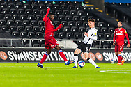 Reading FC's Alfa Semedo Esteves (30) and Swansea City's Jay Fulton (6) come together during the EFL Sky Bet Championship match between Swansea City and Reading at the Liberty Stadium, Swansea, Wales on 30 December 2020.