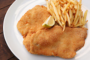 schnitzel, breaded fried meat cutlet of poultry breast with chips