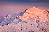 Pastel colored glow on Mt. McKinley summit, Denali National Park & Preserve, Interior Alaska, Summer.