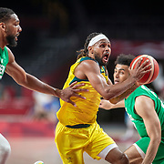 TOKYO, JAPAN - JULY 25: Patty Mills #5 of Australia drives past Jahlil Okafor #15 of Nigeria during the Australia V Nigeria basketball preliminary round match at the Saitama Super Arena at the Tokyo 2020 Summer Olympic Games on July 25, 2021 in Tokyo, Japan. (Photo by Tim Clayton/Corbis via Getty Images)