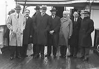H933 Retired World Champion Gene Tunney with the members of the Tailteann committee who greeted him in Holyhead.  Left to right: Mr. Sean Clarke, Mr. J.J. Healy, Surgeon Keegan, Mr. Tunny, Mr. J. McSwiney, Mr. P. lynch, Mr. J.J. O'Toole, and Major-Gen. Hohan. 24th August 1928. (Part of the Independent Newspapers Ireland/NLI Collection)