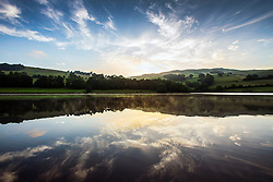 © Licensed to London News Pictures. 28/06/2016. Derwent Valley UK. Picture shows this morning's sunrise over Ladybower Reservoir in the upper Derwent Valley, Derbyshire. Photo credit: Andrew McCaren/LNP
