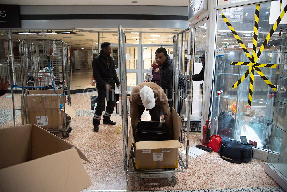 Shop keepers pack up their businesses on the final day of trading at the Elephant and Castle shopping centre on 24th September 2020 in London, United Kingdom. Built in the 1960's, the complex will be demolished and redeveloped by property developer Delancy  who plan to regenerate the area, building 1,353 new flats, 330 will be affordable housing.
