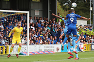 AFC Wimbledon striker Kweshi Appiah (9) winning header during the EFL Sky Bet League 1 match between AFC Wimbledon and Coventry City at the Cherry Red Records Stadium, Kingston, England on 11 August 2018.