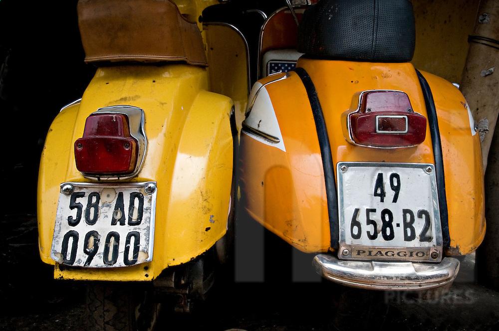 Rusty old yellow vintage vespa. Ho Chi Minh, Vietnam, Asia