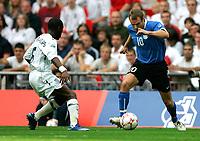 Photo: Tom Dulat.<br /> England v Estonia. UEFA European Championships Qualifying. 13/10/2007.<br /> Joel Lindpere of Estonia and Shaun Wright-Phillips of England with the ball.