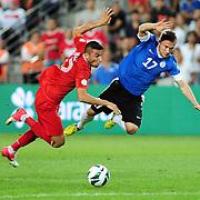 Turkey's Burak Yilmaz (L) and Estonia's Enar JAAGER  during their FIFA World Cup 2014 qualifying soccer match Turkey betwen Estonia at Sukru Saracoglu stadium in Istanbul September 11, 2012. Photo by TURKPIX