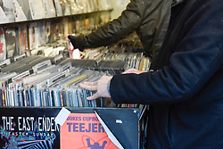 © Licensed to London News Pictures. 13/04/2019. LONDON, UK. Customer browse in Reckless Records. Analogue music fans visit independent record shops in Soho to celebrate vinyl music on the 12th Record Store Day.  Over 200 independent record shops across the UK come together annually to celebrate the unique culture of analogue music with special vinyl releases made exclusively for the day.  In 2018, sales of vinyl rose for the 11th consecutive year to 4.2 million units according to the British Phonographic Industry (BPI).  Photo credit: Stephen Chung/LNP