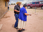 "13 JULY 2012 - FT DEFIANCE, AZ:  JIMMY ETSITTY, a Navajo preacher, and his wife leave the chow hall after he preached a sermon before lunch at the 23rd annual Navajo Nation Camp Meeting in Ft. Defiance, north of Window Rock, AZ, on the Navajo reservation. Etsitty said he was raised to be a Navajo medicine man and that his family turned away from him when he became a Christian. Preachers from across the Navajo Nation, and the western US, come to Navajo Nation Camp Meeting to preach an evangelical form of Christianity. Evangelical Christians make up a growing part of the reservation - there are now more than a hundred camp meetings and tent revivals on the reservation every year. The camp meeting in Ft. Defiance draws nearly 200 people each night of its six day run. Many of the attendees convert to evangelical Christianity from traditional Navajo beliefs, Catholicism or Mormonism. ""Camp meetings"" are a form of Protestant Christian religious services originating in Britain and once common in rural parts of the United States. People would travel a great distance to a particular site to camp out, listen to itinerant preachers, and pray. This suited the rural life, before cars and highways were common, because rural areas often lacked traditional churches. PHOTO BY JACK KURTZ"