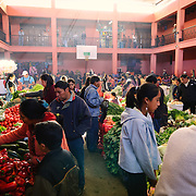 Fresh fruits and vegetables for sale in as part of the Chichi Sunday market. Chichicastenango is an indigenous Maya town in the Guatemalan highlands about 90 miles northwest of Guatemala City and at an elevation of nearly 6,500 feet. It is most famous for its markets on Sundays and Thursdays.
