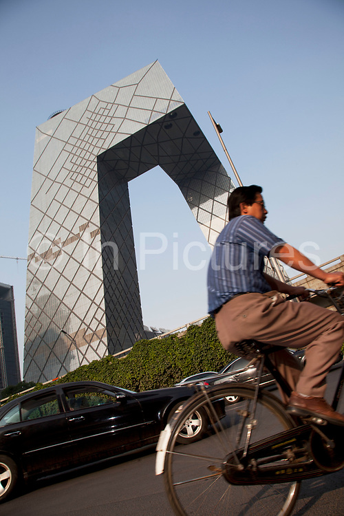 Cycling past the CCTV Headquarters is a 234m 44-storey skyscraper in the Beijing Central Business District or CBD. Affectionately known by the Chinese locals as The Underpants Building due to it's unique design. The tower serves as headquarters for China Central Television. Construction began in 2004 and the building's facade was completed in 2008. After the construction having been delayed as result of a fire which in February 2009 engulfed the adjacent Television Cultural Center, the Headquarters has been finally completed in May 2012. Rem Koolhaas and Ole Scheeren of OMA were the architects in charge for the building, while Arup provided the complex engineering design.