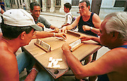 MARCH 19, 2001 - HAVANA, CUBA: Men play dominoes on a street in the centro section of Havana, Cuba, March 19, 2001. Dominoes are a passion among Cuban men and it's not unusual to find several games going on at the same time on the street in the residential sections of Havana. PHOTO BY  JACK KURTZ          LIFESTYLE   CULTURE   SPORTS