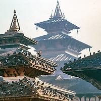 Pigeons rest on pagoda roofs in Kathmandu Durbar Square, Nepal, 1986.