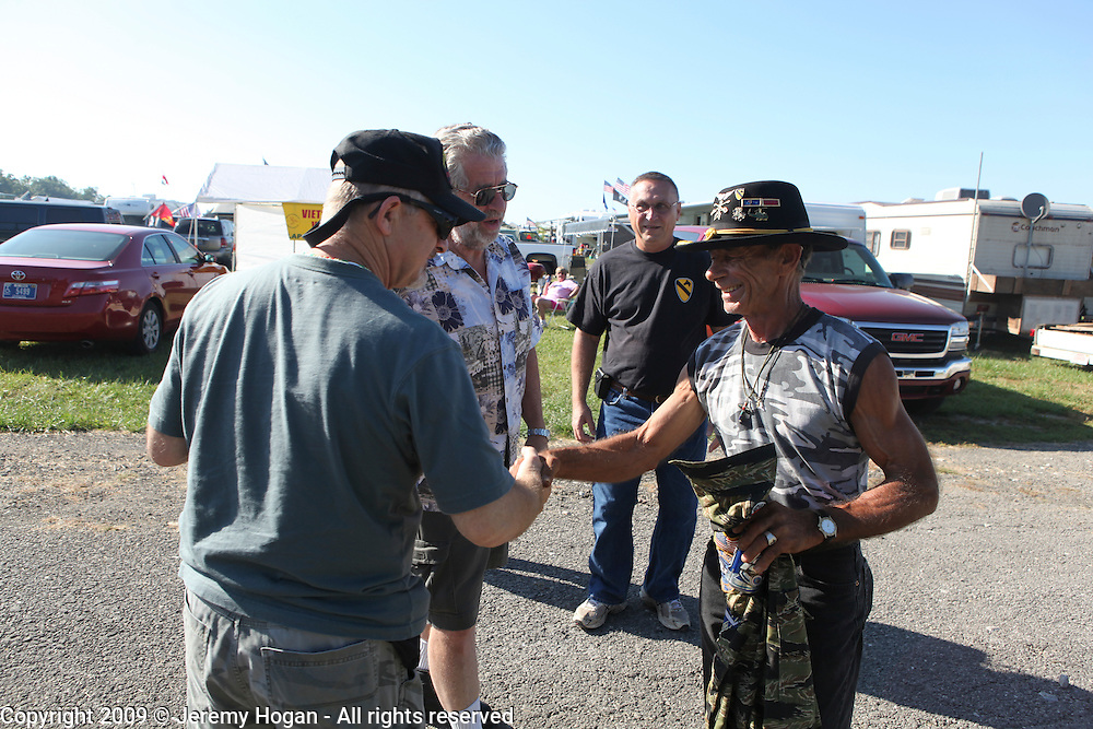 Jerry Hogan, B Troop, 1/9th Cavalry, right, meets Veterans of the 7th Cavalry. Vietnam Veterans gather in Kokomo, Indiana for the 2009 reunion.