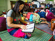 28 NOVEMBER 2017 - YANGON, MYANMAR: A woman from upcountry Myanmar who said she is going to the papal mass Wednesday, reads her hymnal in the sanctuary at St. Francis of Assisi Church in Yangon. About 1,500 people are camping at the church before the papal mass at Kyaikkasan Sports Ground, about three kilometers from the church.    PHOTO BY JACK KURTZ