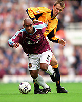 Trevor Sinclair (West Ham United) Dietmar Hamann (Liverpool). West Ham United 1:1 Liverpool, F.A. Carling Premiership, 17/9/2000. Credit: Colorsport / Stuart MacFarlane.