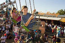 United States, Washington, Puyallup, people on giant swing ride at state fair