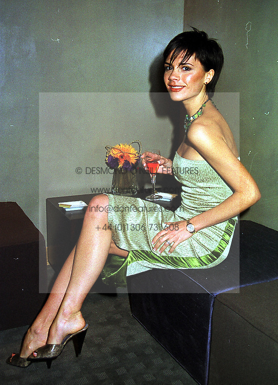 Spice Girl VICTORIA BECKHAM wife of footballer David Beckham, at a party in London on 8th November 1999.MYS 23