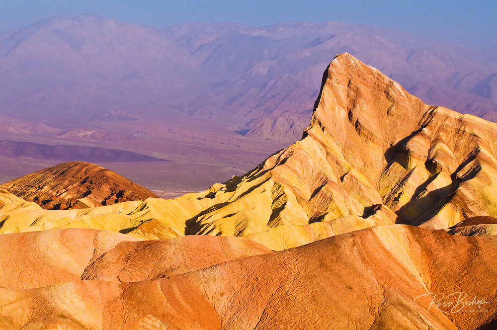 Dawn light on Manly Beacon from Zabriskie Point, Death Valley National Park. California USA