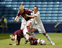 Photo: Chris Ratcliffe.<br /> Leeds United v Arsenal. Womens' FA Cup Final. 01/05/2006.<br /> Natalie Preston (R) of Leeds tussles for the ball with Leanne Champ (C) and Faye White (on floor) of Arsenal.