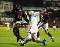 Photo: Chris Ratcliffe.<br /> Arsenal v Real Madrid. UEFA Champions League. 08/03/2006.<br /> Ronaldo is tackled by Kolo Toure