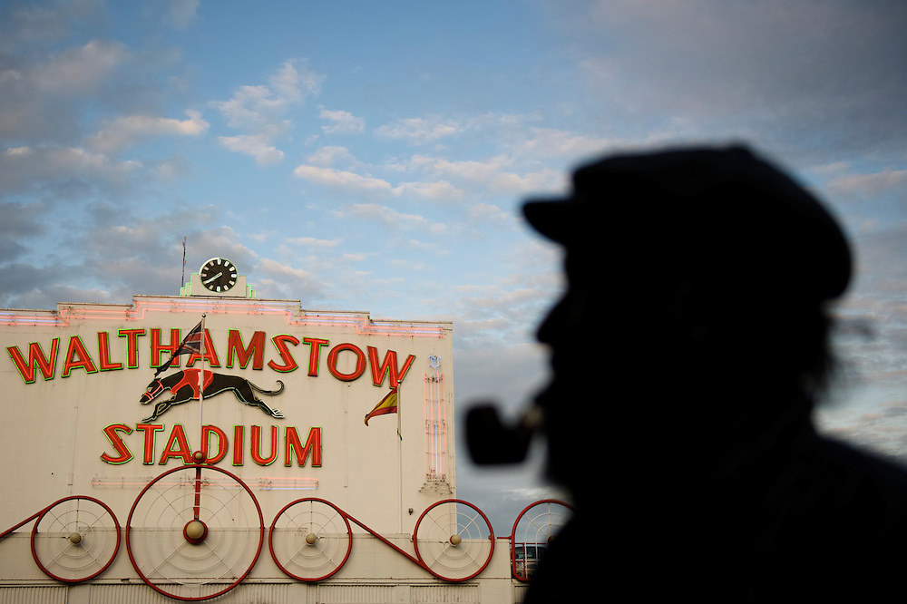 """Walthamstow, England.  August 16, 2008.  Lifelong Walthamstow resident Jeff Harris, 65, admires the famous stadium at dusk, on the final night of racing in its 75 year history.  """"What a shame and loss for the heritage of England,"""" Harris said.  Forced to close as a result of diminishing profits and poor attendance, record crowds flocked to take in the festivites one last time.  .."""