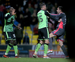 Plymouth Argyle's Remi Matthews is congratulated by Sonny Bradley after he saves the penalty