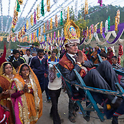 Groom carried out on a sedan chair. Traditional wedding in the Himalaya.