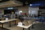 A closed food court a Sky Harbor International Airport amid the global coronavirus COVID-19 pandemic, Thursday, April 1, 2021, in Phoenix.