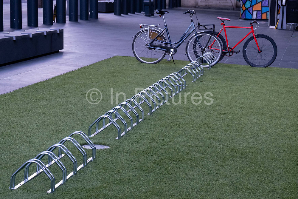 As Londoners are still told to work from home, just two bicycles are locked-up at bike racks outside the Leadenhall building during the third lockdown of the Coronavirus pandemic, in the City of London, the capitals financial district, aka The Square Mile, on 2nd February 2021, in London, England.