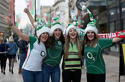 Irish fans pose with a half-and-half scarf prior to the RBS Six Nations at the Principality Stadium, Cardiff.