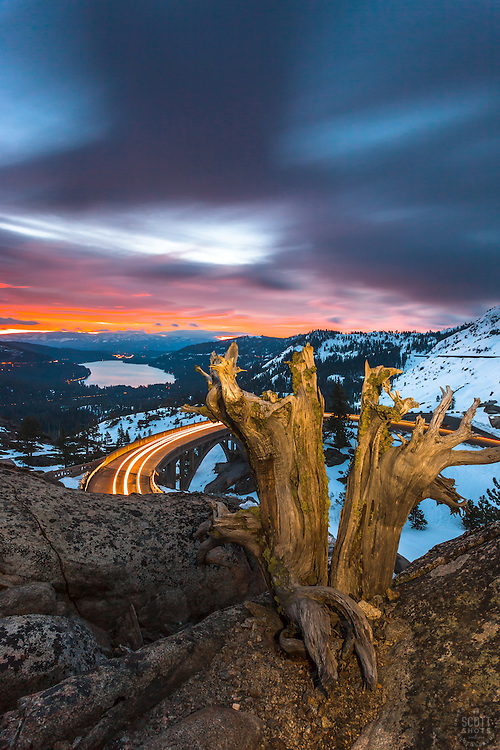 """""""Donner Lake Sunrise 14"""" - Photograph of a vibrant sunrise above Donner Lake and Rainbow Bridge with a old dead stump in the foreground."""