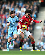 James Milner of Manchester City tussles with Marouane Fellaini of Manchester United - Barclays Premier League - Manchester City vs Manchester Utd - Etihad Stadium - Manchester - England - 2nd November 2014  - Picture David Klein/Sportimage