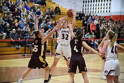 Hanover senior Willa Parkins grabs a rebound away from Lebanon defensemen in the NHIAA Division II semi-final game at Pinterton Academy in Derry on Wednesday, March 11, 2020.  (Alan MacRae/Valley News)