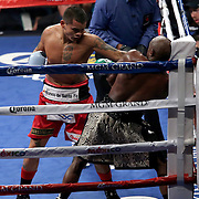 LAS VEGAS, NV - SEPTEMBER 13: Marcos Maidana (L) throws a jab at Floyd Mayweather Jr. during their WBC/WBA welterweight title fight at the MGM Grand Garden Arena on September 13, 2014 in Las Vegas, Nevada. (Photo by Alex Menendez/Getty Images) *** Local Caption *** Floyd Mayweather Jr; Marcos Maidana