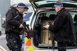 © Licensed to London News Pictures. 05/03/2019. London, UK. Armed police at London City Airport where police were called to reports of a suspicious package. Suspicious packages have also been found at Heathrow Airport and London Waterloo Station. Photo credit: Rob Pinney/LNP