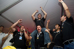 Uros Rapotec of Cimos Koper, Robert Konecnik of Cimos Koper, Matjaz Brumen of Cimos Koper, Bojan Skoko of Cimos Koper and fans celebrate  after the handball match between RK Cimos Koper (SLO) and SL Benfica (POR) in return final match of EHF Challenge Cup, on May 22, 2011 in Tent at Arena Bonifika, Koper, Slovenia. Koper defeated Benfica 31-27 and became Euro Challenge Champion 2011. (Photo By Vid Ponikvar / Sportida.com)
