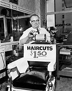 Y-530624B.  Frank Penner, barber, Sovereign Hotel shop, June 24, 1953