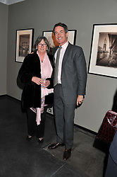 TIM JEFFERIES and his mother HILARY JEFFERIES at a private view of photographs by Christopher Thomas entit;ed 'Venice in Solitude' held at Hamiltons, 13 Carlos Place, London on 31st January 2012.